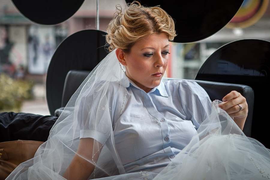Bride waits for her turn at hair salon