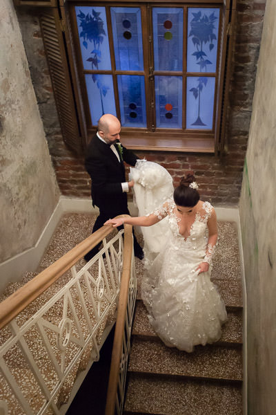 bride groom walking down the stairs at beykoz shoe factory