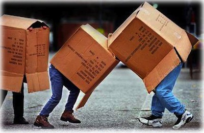 Kids play with cardboard boxes
