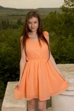 Emily Bloom Takes Off Her Orange Dress 1