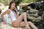 Gorgeous toned brunette Mila Azul takes off her sexy white swimsuit 3