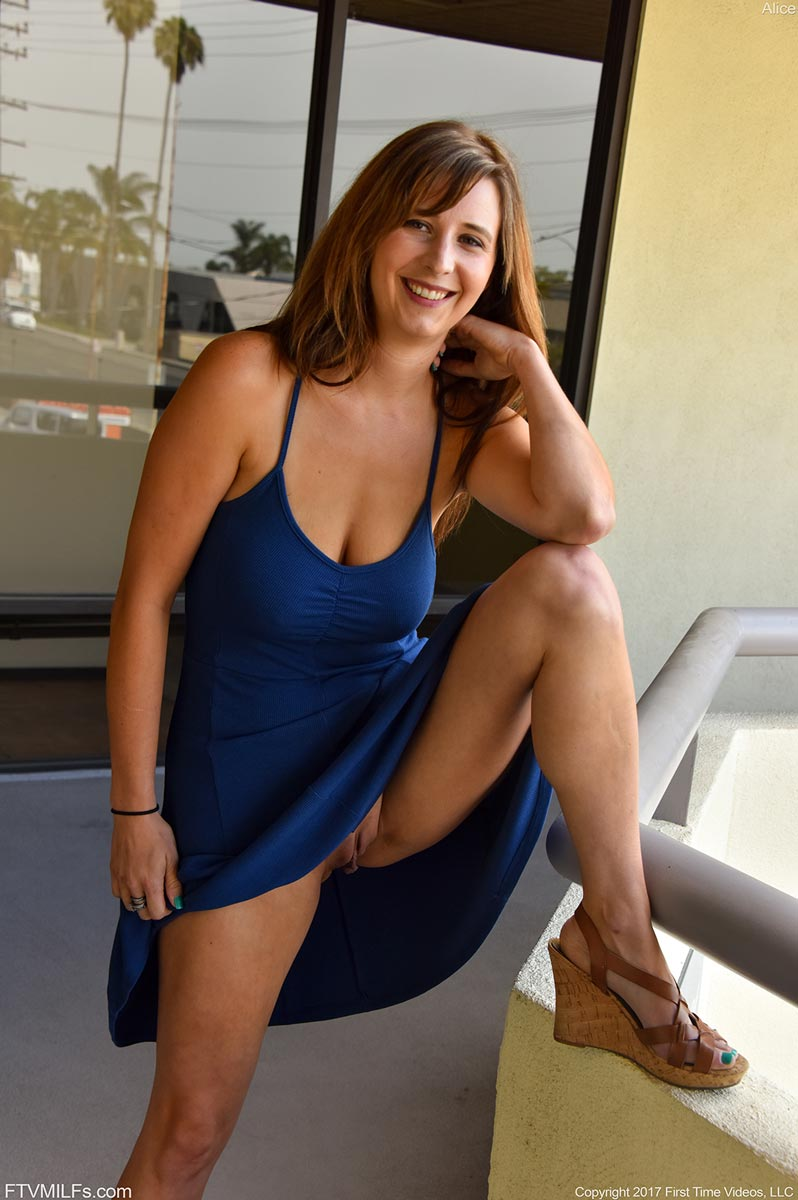 Alice Chambers in a Blue Dress
