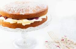 A cake filled with whipped cream and jam
