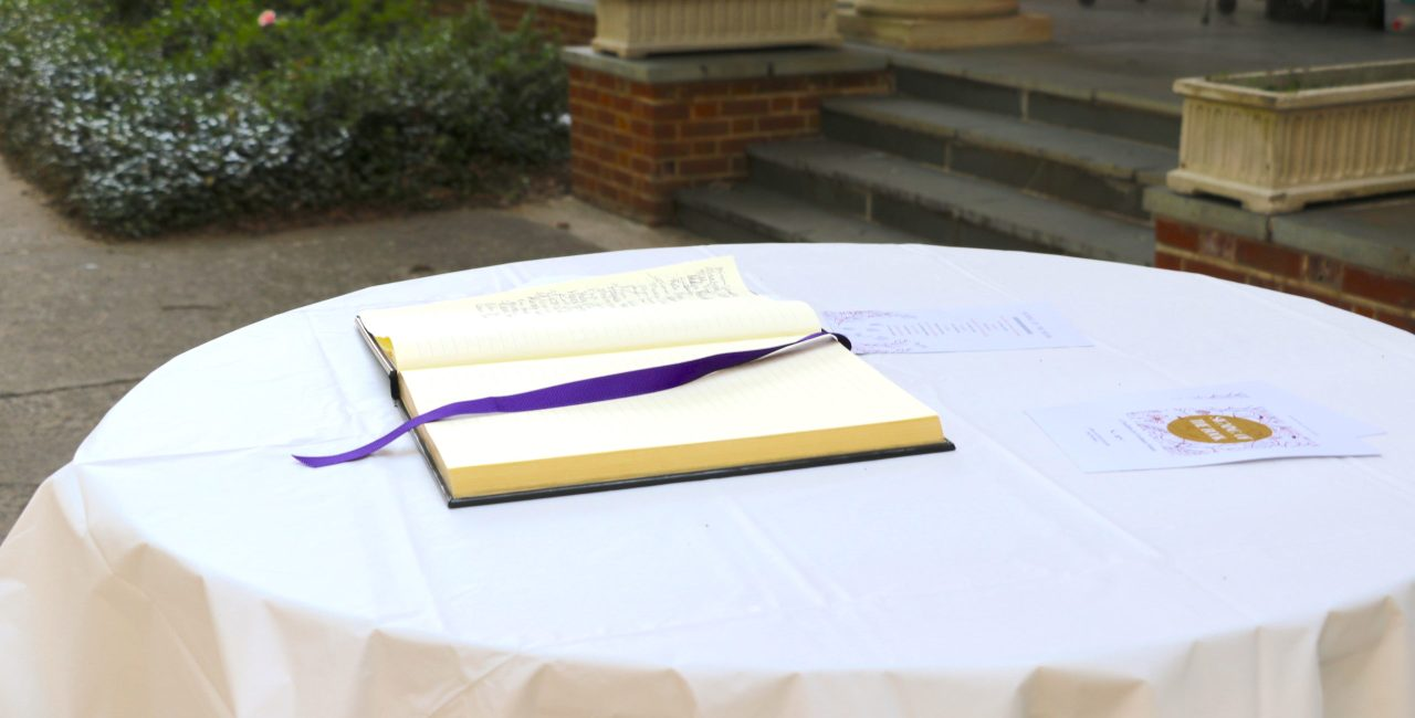 Signing Of The Book Tradition Continues In An Outdoor Setting