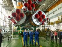 Soyuz TMA-03M posing with their launcher