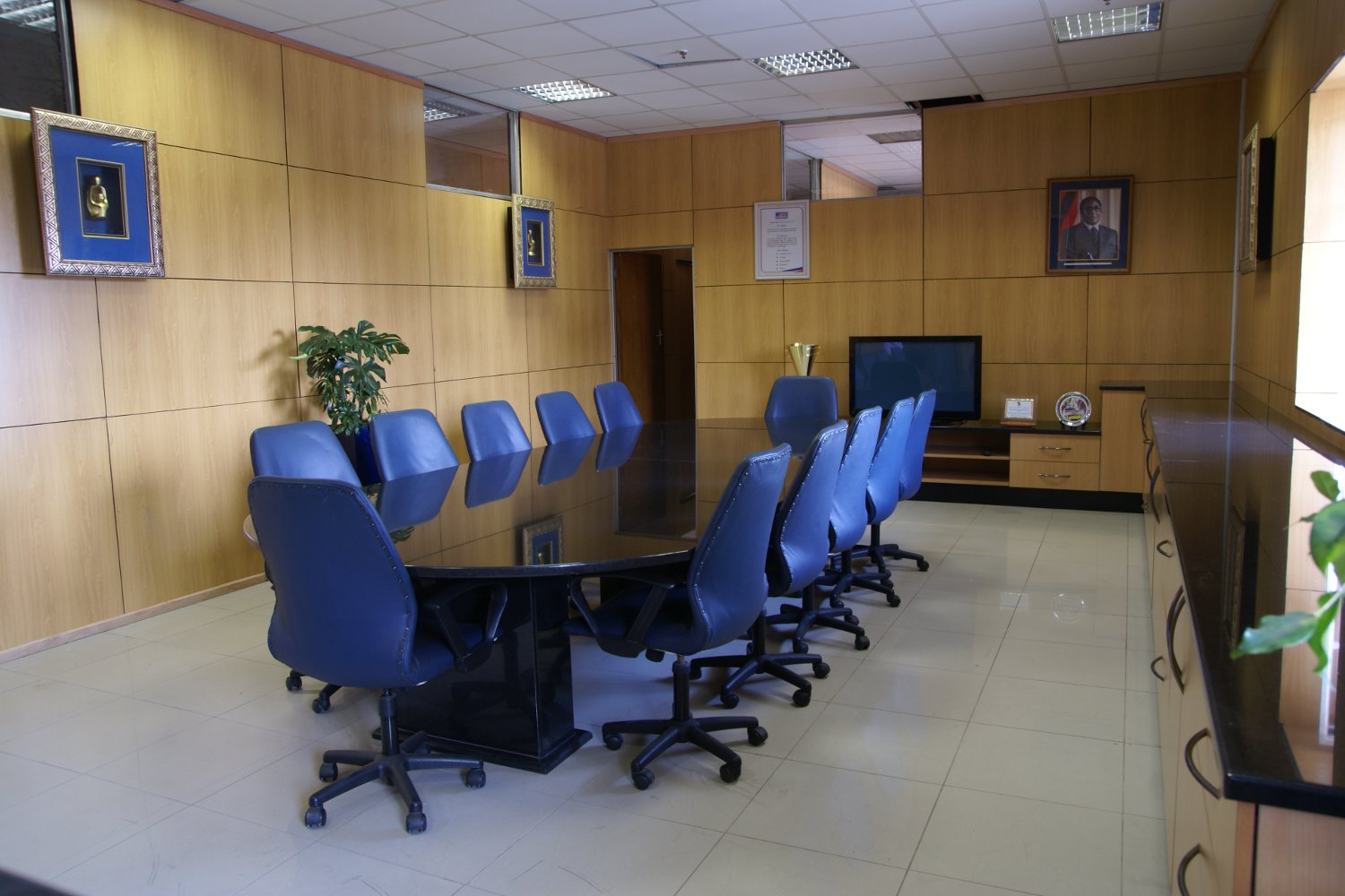 office chairs zimbabwe rust orange accent chair boardroom furniture and design esaja for