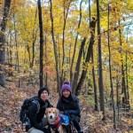 Fall foliage in Virginia couple and dog