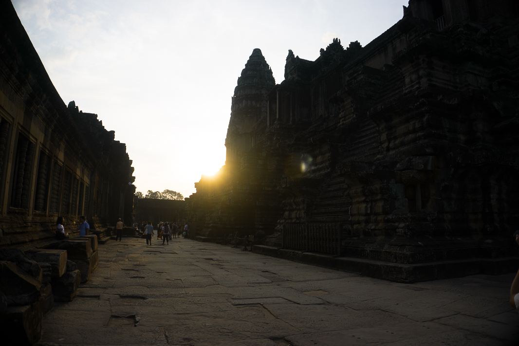 """There's only one reason to be waking up at 4am in Siem Reap. It's a seriously good reason though. No visit to Siem Reap would be complete without visiting Angkor Wat. Over 900 years ago, this huge complex was once the capital city of the Khmer Empire and it's just awesome to think that so much of it is still here today. No matter what you do, you have to spend at least 1 day at Angkor Wat. I'd previously visited Angkor Wat when I was last in Cambodia, but I can say for sure, it's no less incredible seeing it a second time around. Looking around was still a non-stop string of """"woahs"""" and """"can you imagine"""". WoahI can't believe this is still standing and can you imagine all this detail being carved out by hand?. No matter how many times you visit here, there's no way you could see it all. So yes, while this handful of my favourite photos may not even begin to scratch the Angkor Wat surface, I hope you enjoy them and inspire you to add a trip to your bucket list! Angkor Wat for sunrise Does this really require an introduction? I opted for an early sunrise trip (you can also do a sunset trip) and although it wasn't exactly a banger, it's still darn magical. Despite its size, finding your way to watch it in the dark was kind of tricky. It's definitely worth the early morning stumbling around though."""