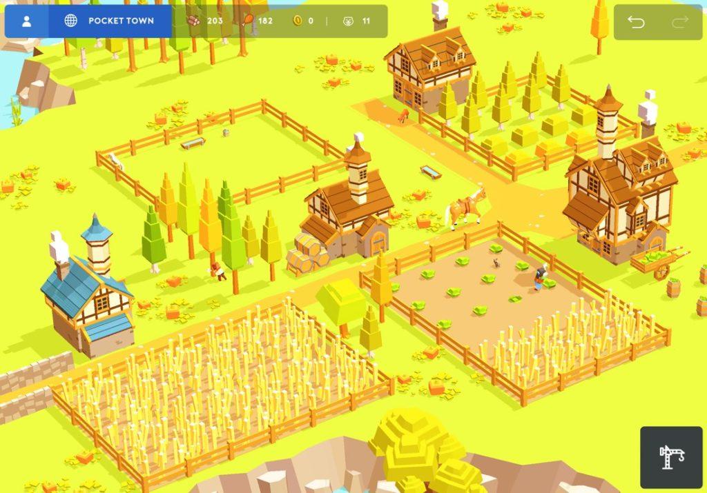 Captura de pantalla del juego Pocket Build. Vista de pájaro del pueblo construido, con algunas casas casas y granjas y aldeanos trabajando. Escena de tonos muy verdes debido a la hierba del suelo.