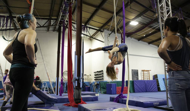 two students on trapeze