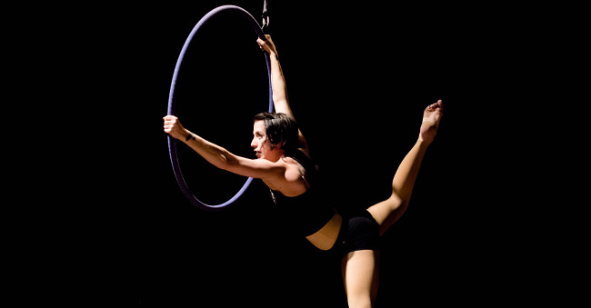 performer posing on aerial hoop