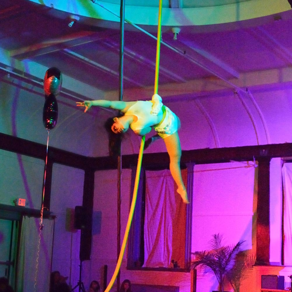 x dai performing on aerial rope