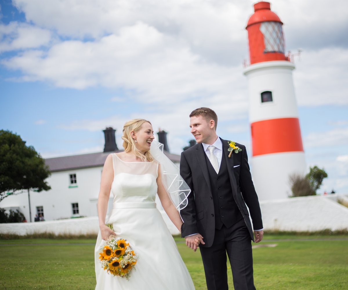 Bride and Groom with lighthouse coastal wedding