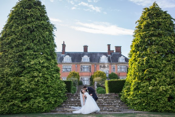 Dunchurch park wedding bride and groom venue in background