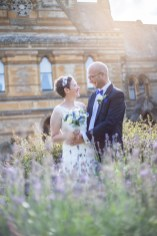 bride and groom in gardens at golden hour