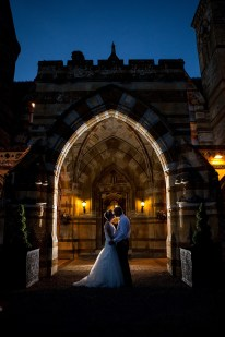 Bride and groom at night under ettington arch way twinkly