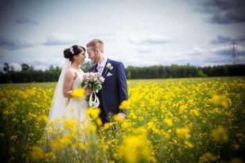 shustoke barn wedding photographer yellow field
