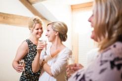 Bridesmaids toasting the Bride at Mythe Barn