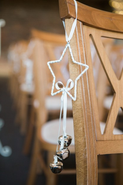 Winter Wedding Mythe Barn Star with bells to decorate ceremony chairs