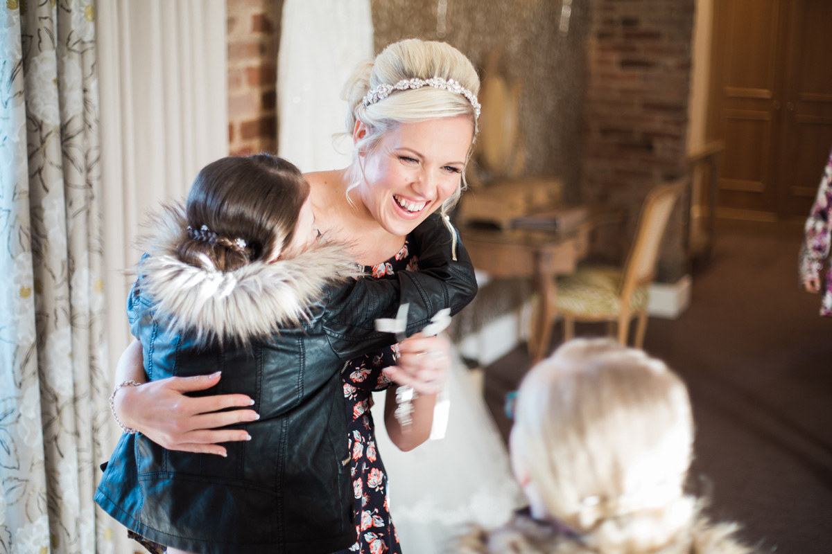Bride seeing children for the first time wedding morning