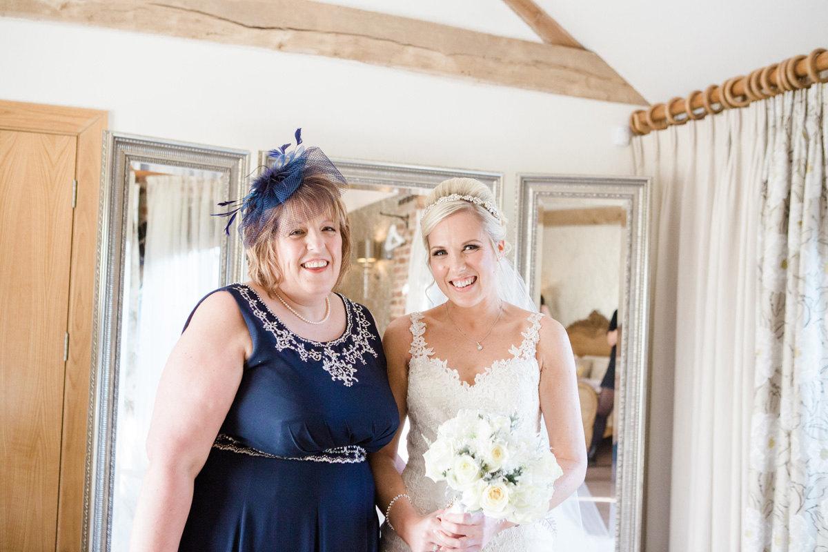 bride and mum before wedding ceremony at Mythe Barn