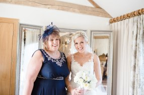 bride and mum before wedding ceremony at Mythe Barn