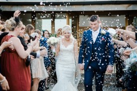 Confetti at silver and blue wedding Mythe Barn