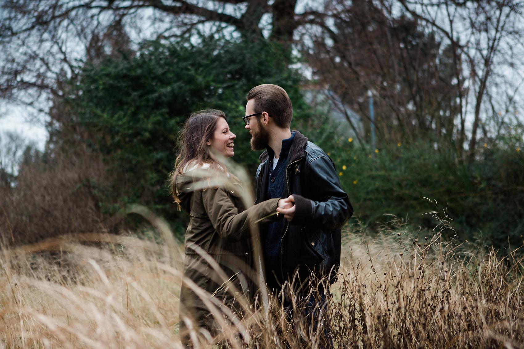 couple dance in long grass pre wedding shoot leamington spa bad weather pre wedding shoot