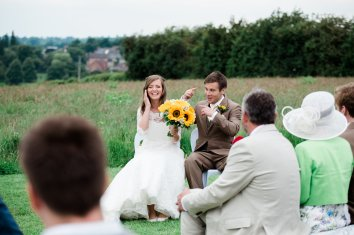 Bride and groom laughing out door ceremony UK