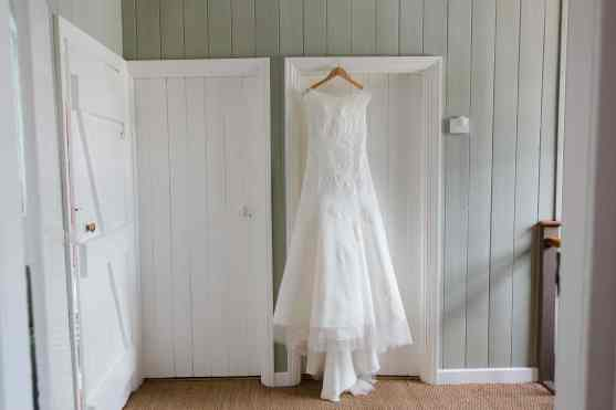 Wedding dress on door at bragborough hall