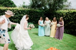 bridesmaid sees bride all dressed up in garden in staffordshire