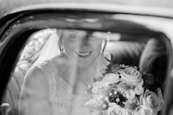 bride portrait through car window as she arrives at church