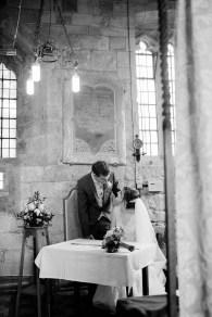 bride and groom sign the register at bradley church
