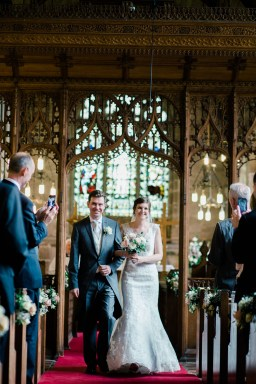 bride and groom walk down the aisle as married couple bradley church