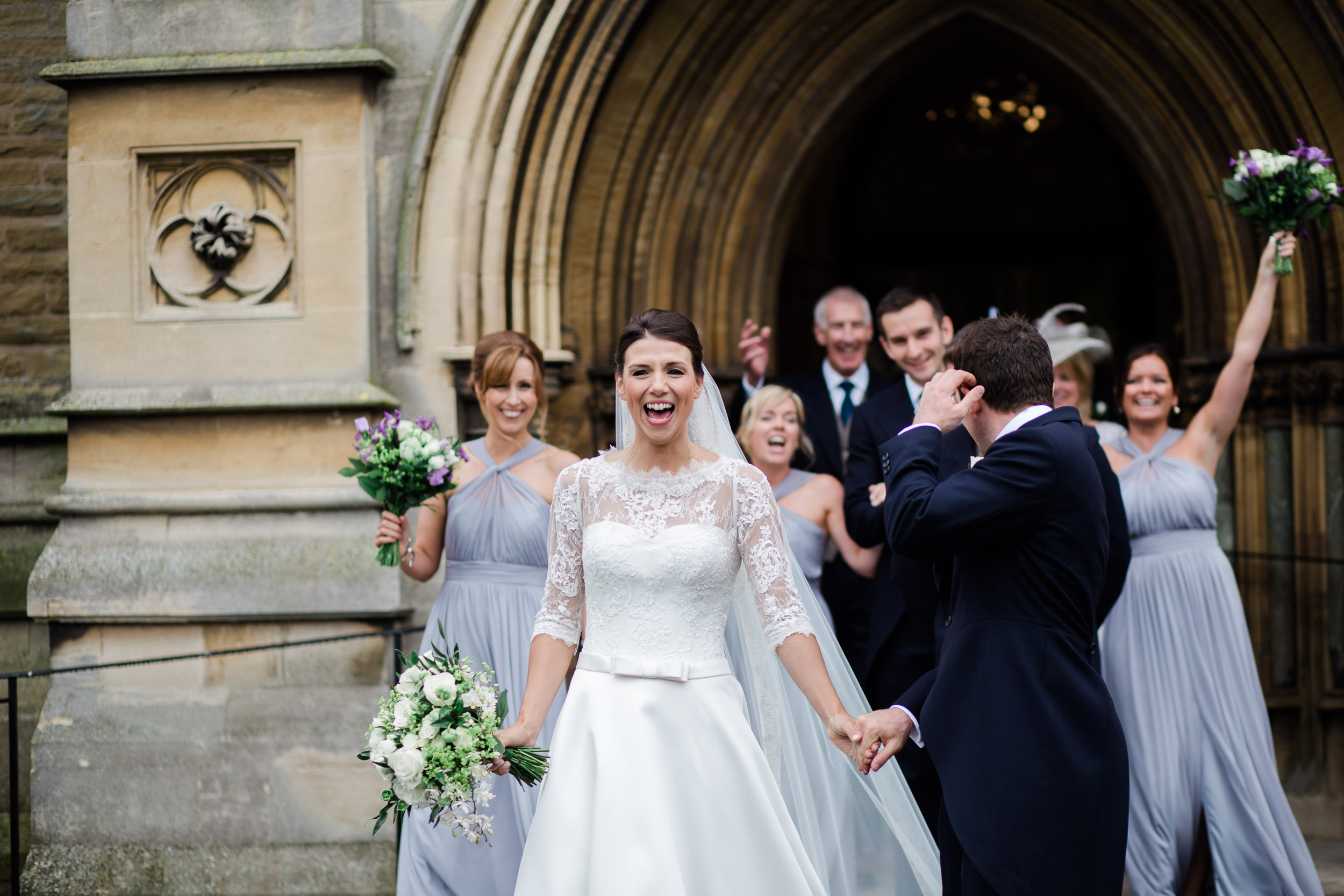 Bride and Groom Celebrating marriage outside church doors st maries