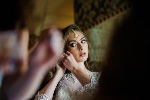 bride putting on jewellery