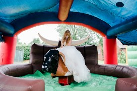 Bride rides mechanical bull at Dorothea Mitchell Church Hall Celverdon Warwickshire