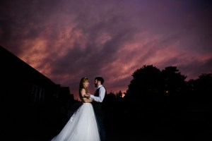 Fun Country Wedding Claverdon Village Hall Bride and Groom at sunset outside Dorothea Mitchell Church Hall Warwickshire
