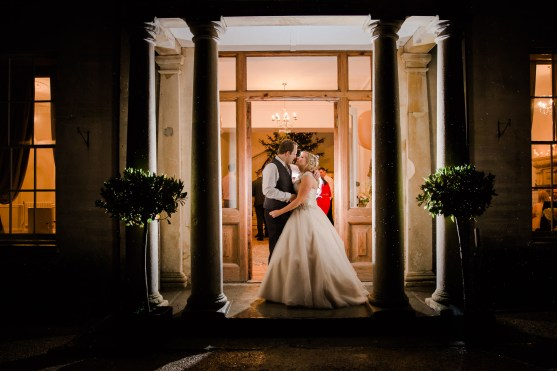 bride and groom night time rain doorway picture vintage art deco Gatsby Style Winter Wedding at Eastington Park