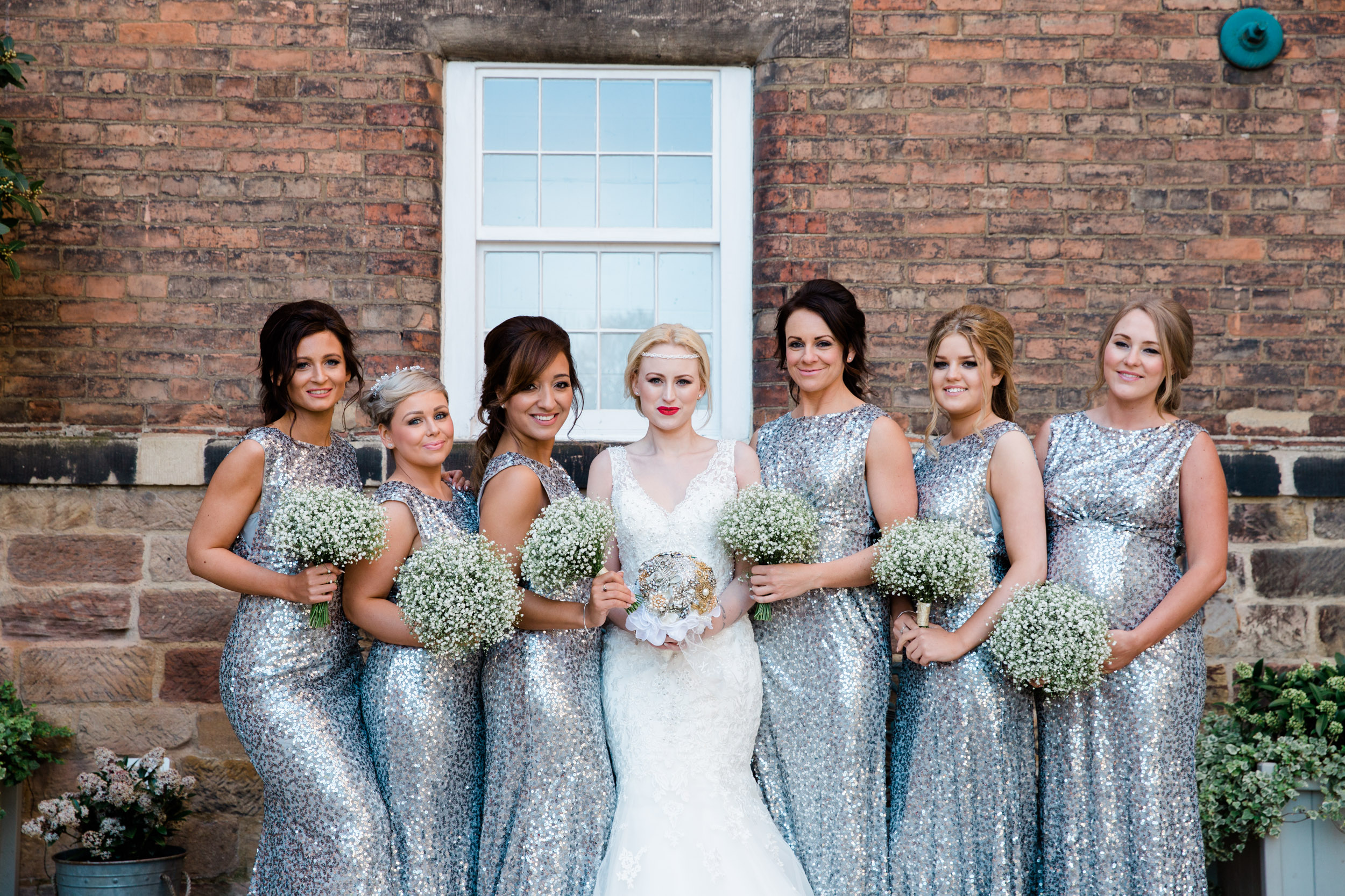bride and bridesmaids west mill industrial brick wall