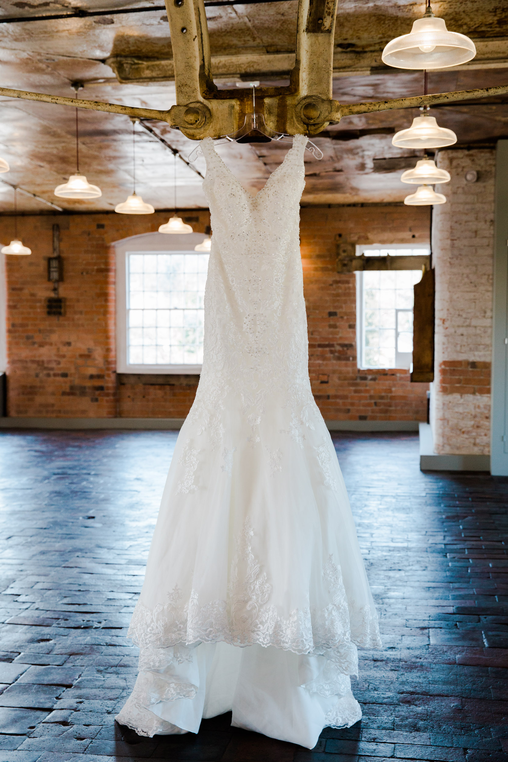 wedding dress hanging in the cotton quarter west mill