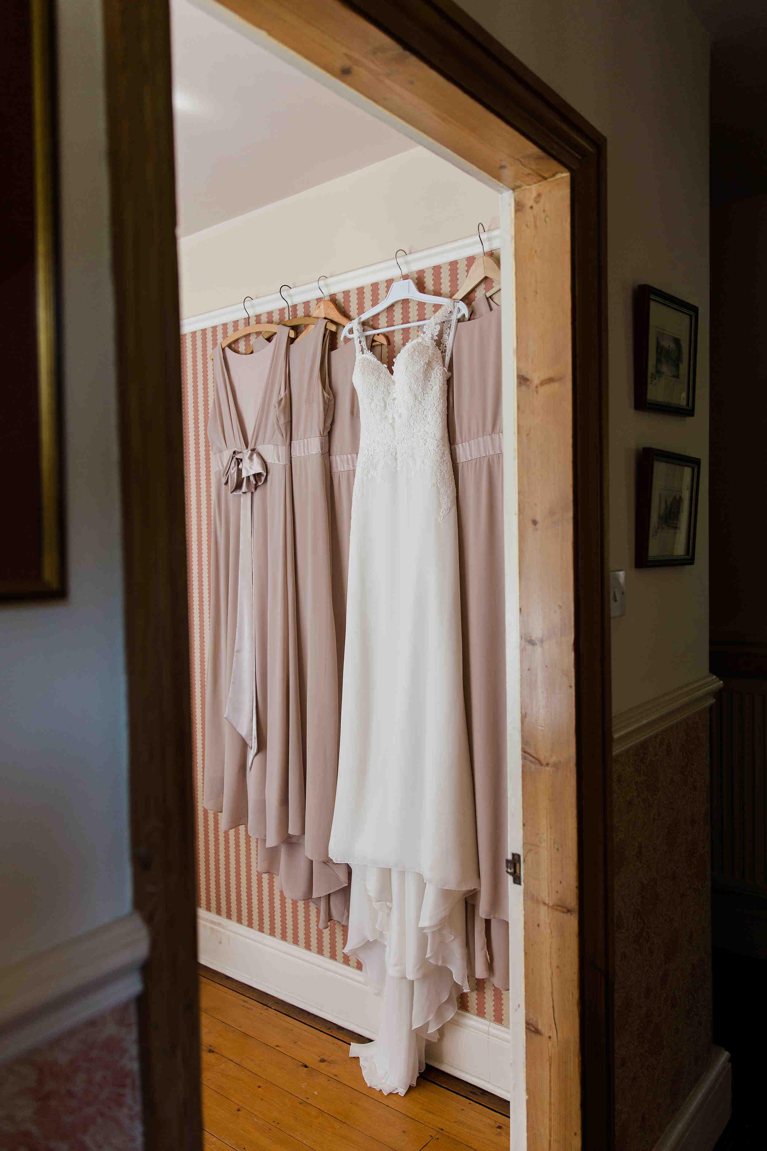 Wedding and bridesmaid dress at family home on wedding morning