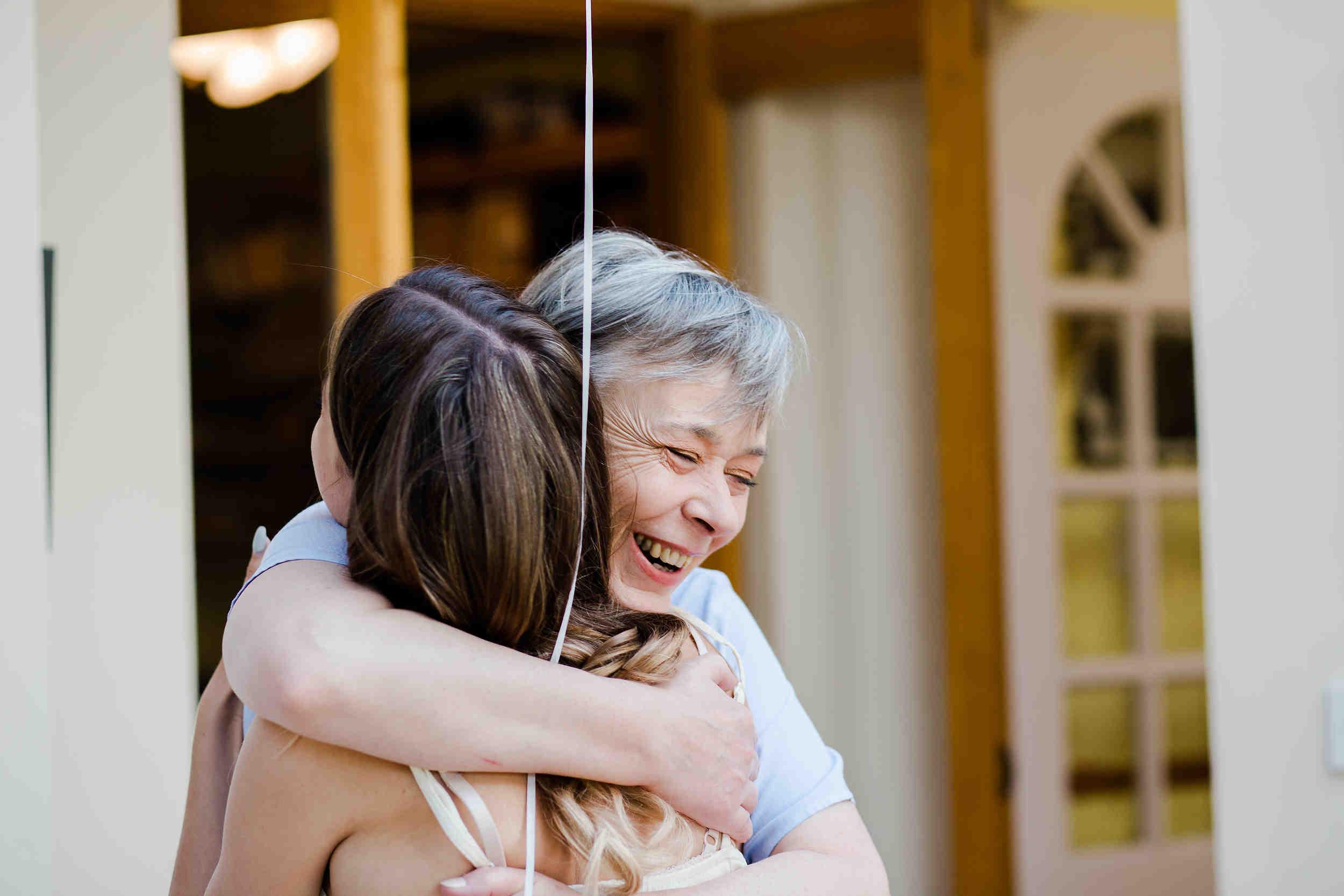 brides mum hugs bridesmaid