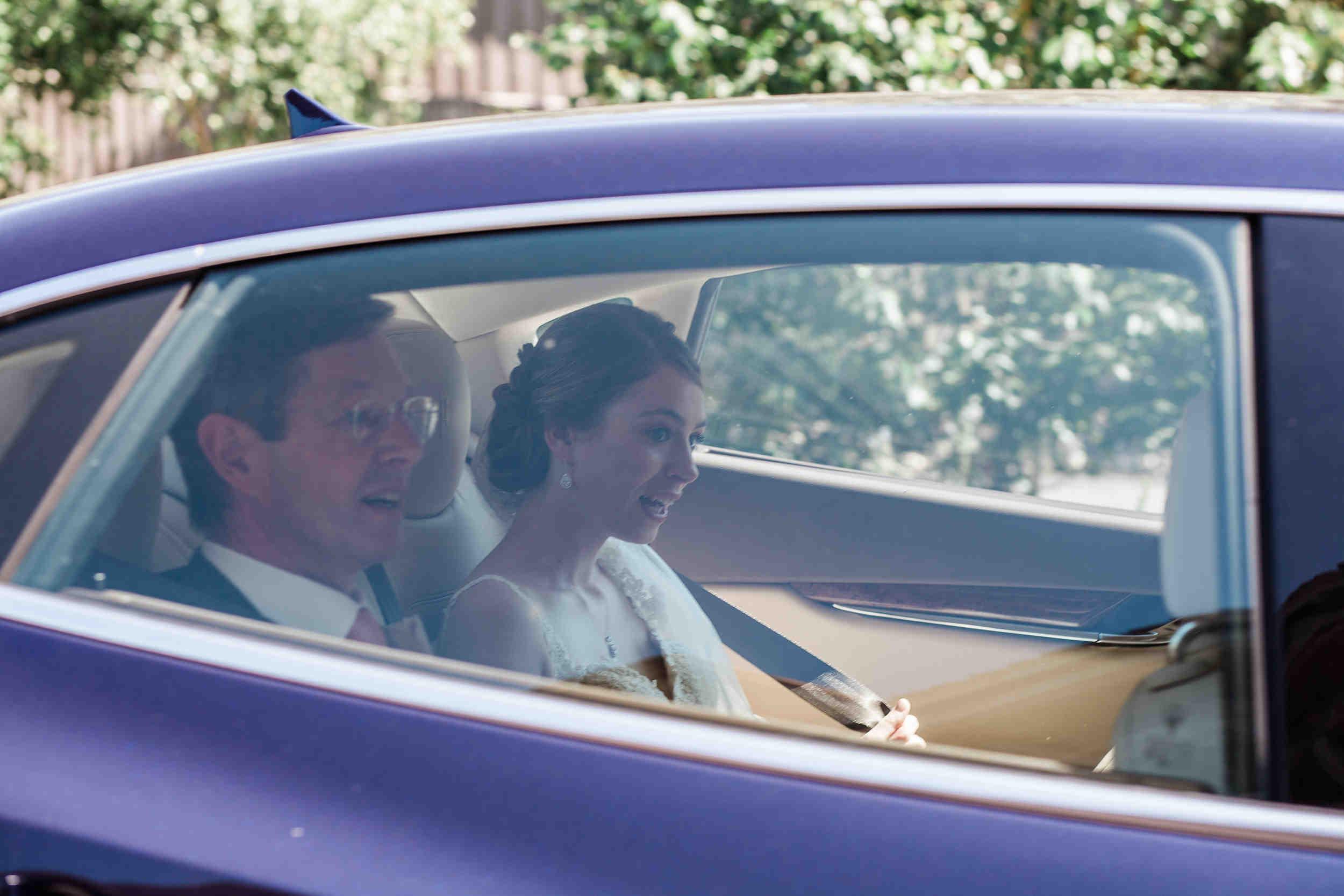 bride arrives in Maserati wedding car