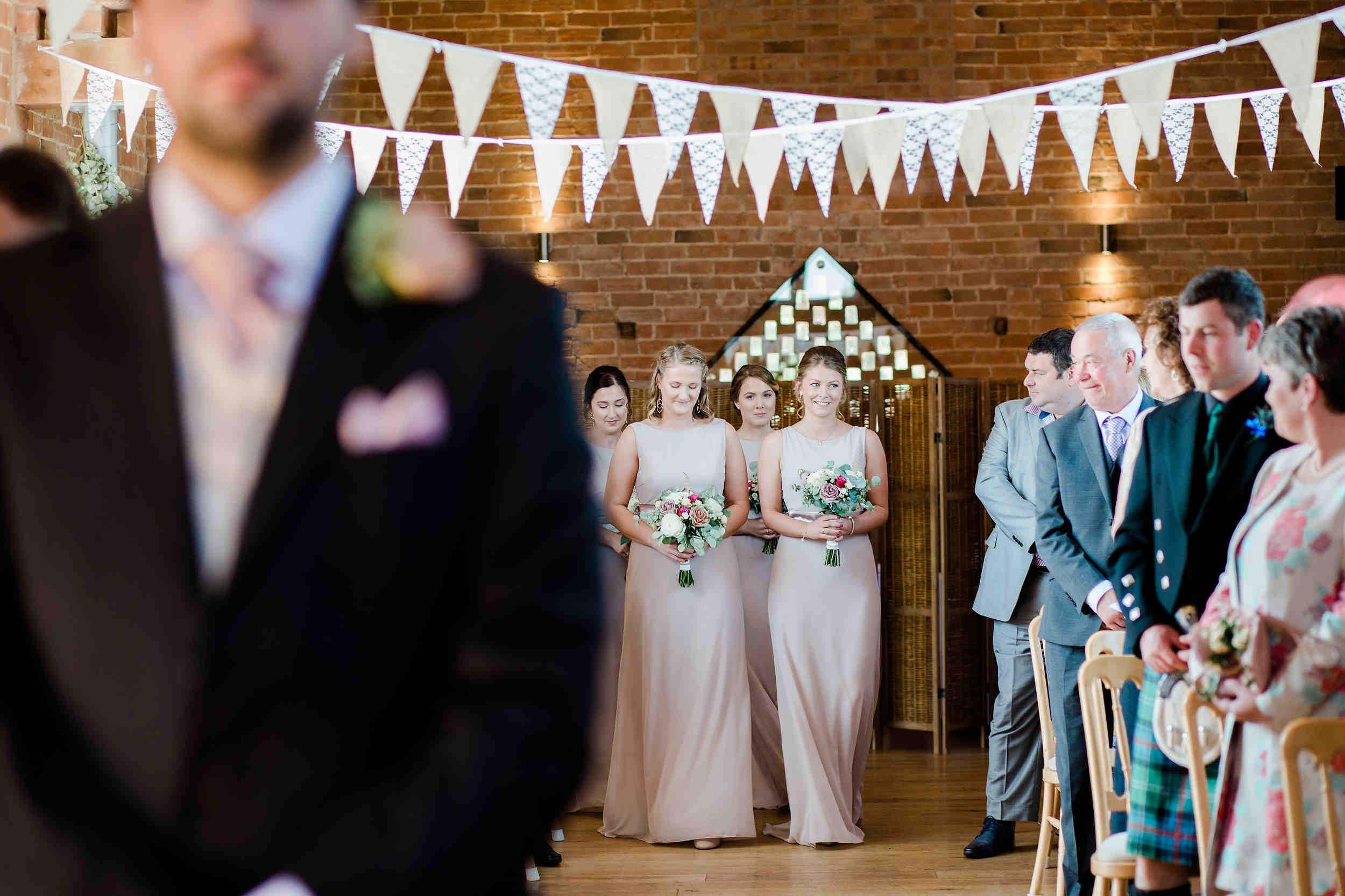 bridesmaids walk down aisle swallows nest barn