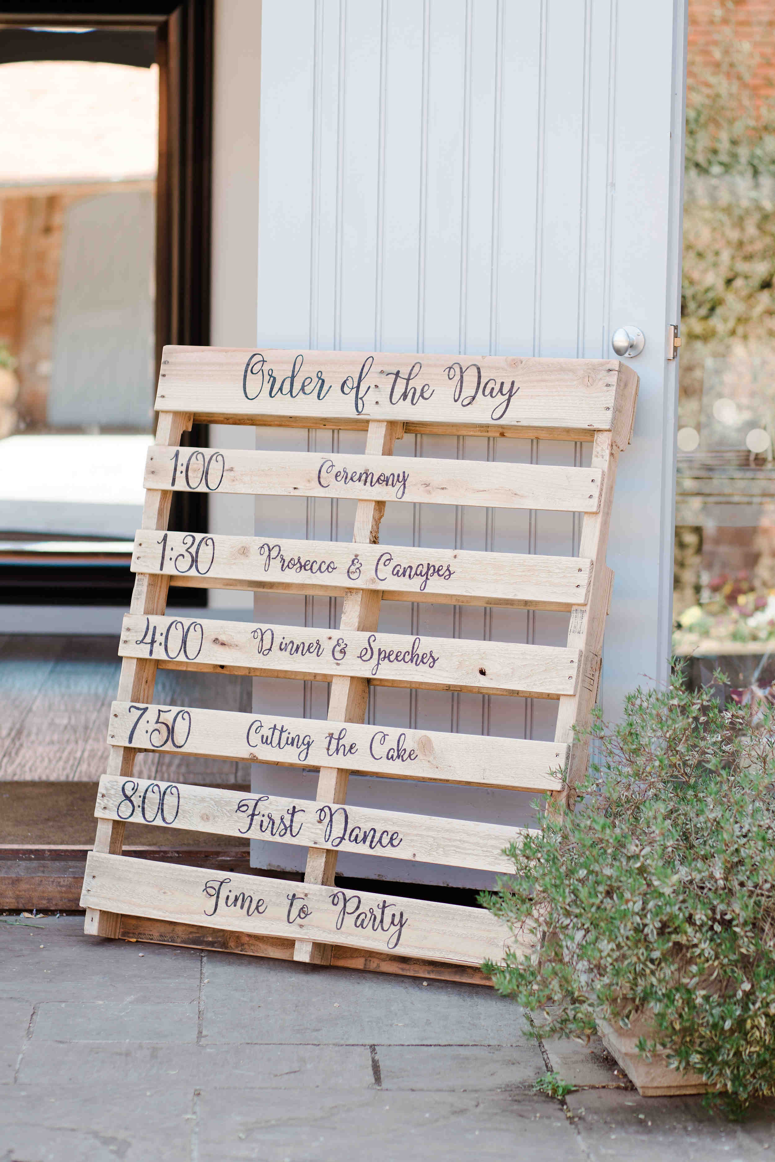 order of the day on wooden pallet diy wedding swallows nest barn