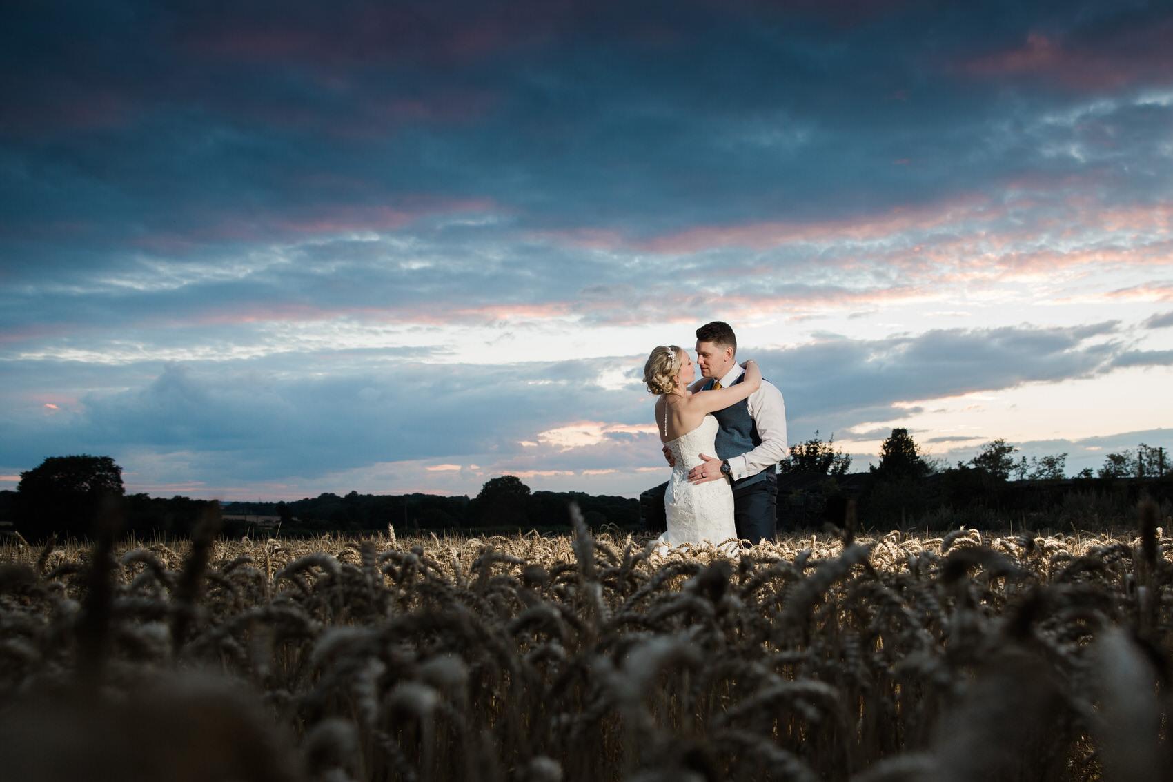 bride and groom at sunset cornfield uk wedding