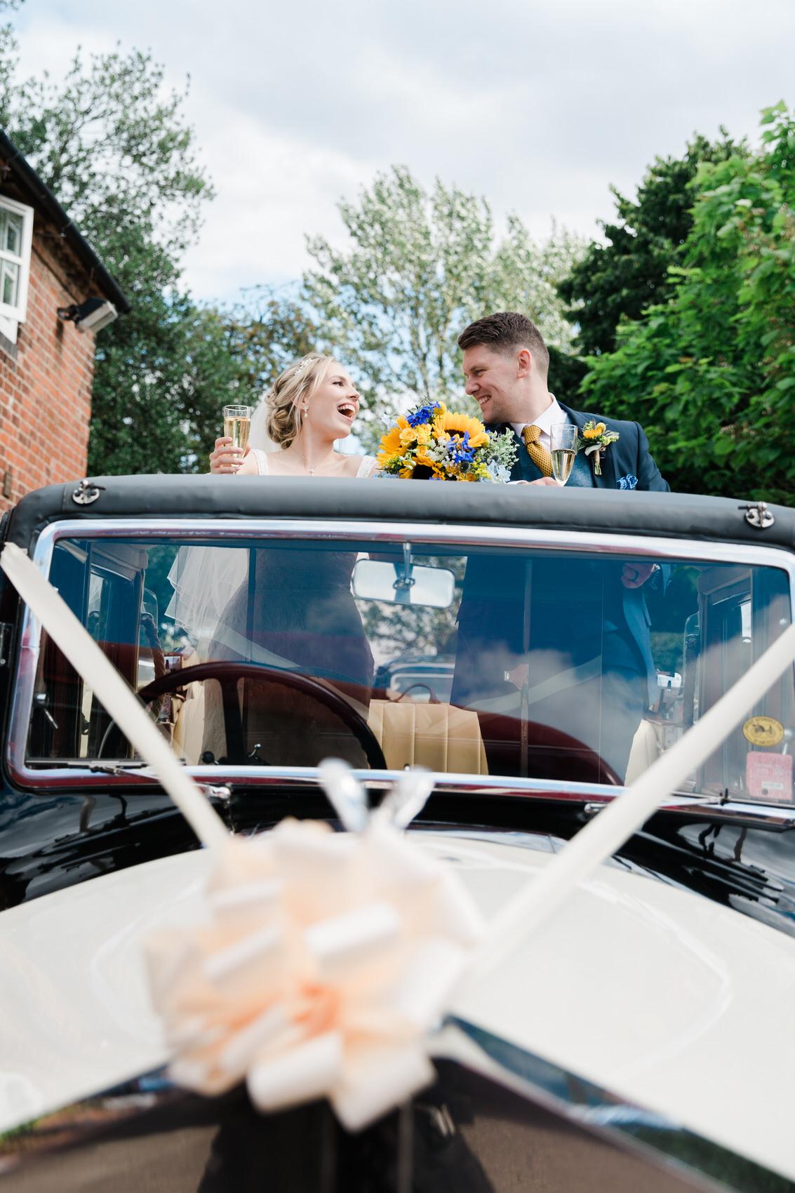 bride and groom fun car photo