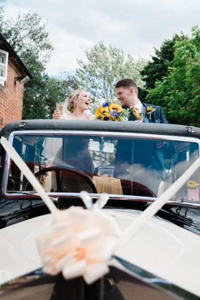bride and groom fun car photo