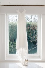 wedding dress hanging in window wedding morning natural relaxed wedding Leamington Spa Relaxed Church reportage photography
